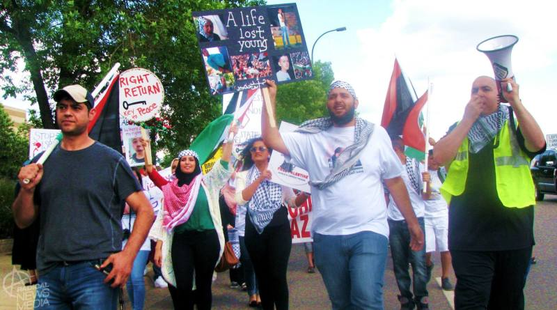 Photo by Sam Wagner.  About 300 protesters demand end to collective punishment of Palestinians.