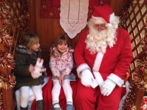 Seeing Father Christmas with her best friend in December 2014