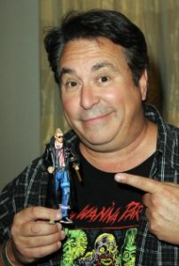 Brian Peck, aka Scuz, with his own action figure. Cool!