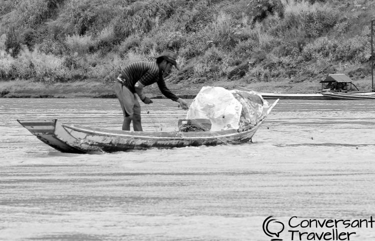 Things to do in Luang Prabang: fisherman on the Mekong