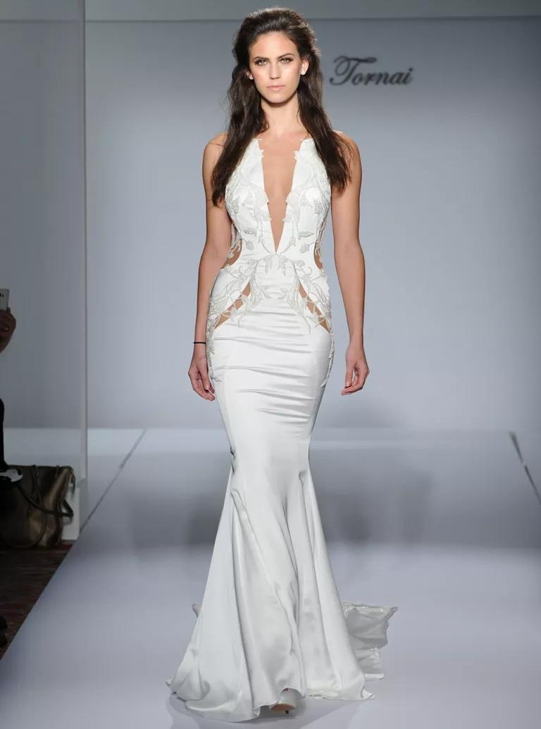pnina tornai wedding dresses bridal fashion week fall sexy wedding dress Pnina Tornai sexy mermaid wedding dress with sheer waist cutouts and plunging v neckline from