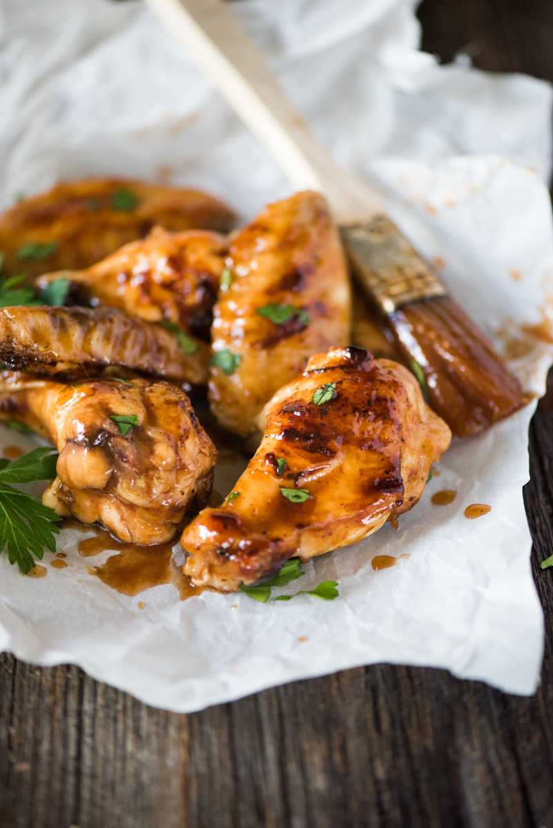 Sticky BBQ Orange Chicken Wings- the honey orange BBQ sauce caramelizes on the chicken as it cooks!