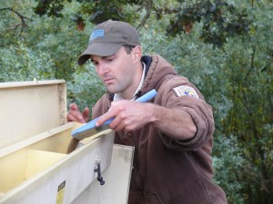 Nate Richardson (US Fish and Wildlife Service) calibrating the seed drill