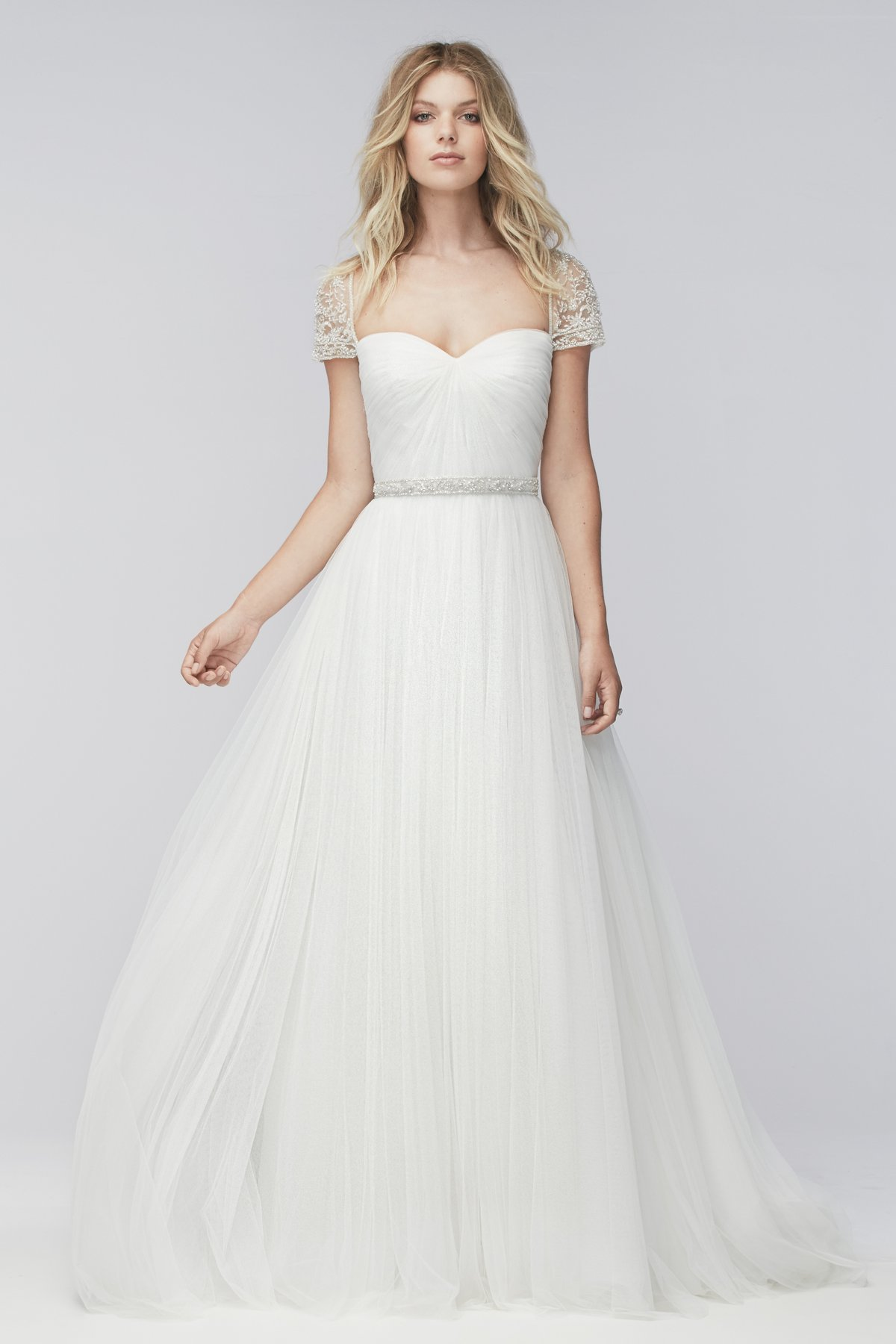 style wedding dress simple wedding dress How to Make a Simple Wedding Dress Look Badass A Practical Wedding We re Your Wedding Planner Wedding Ideas for Brides Bridesmaids Grooms