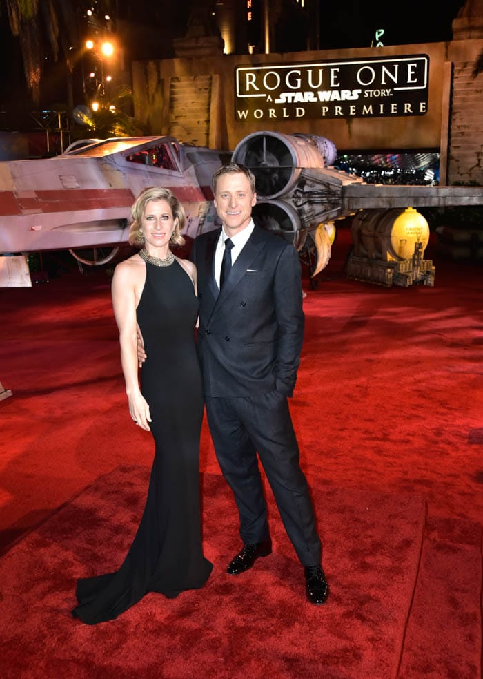 "HOLLYWOOD, CA - DECEMBER 10: Actor Alan Tudyk (R) and Charissa Barton attend The World Premiere of Lucasfilm's highly anticipated, first-ever, standalone Star Wars adventure, ""Rogue One: A Star Wars Story"" at the Pantages Theatre on December 10, 2016 in Hollywood, California. (Photo by Marc Flores/Getty Images for Disney) *** Local Caption *** Alan Tudyk; Charissa Barton"
