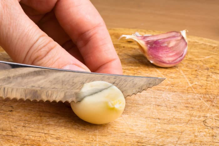 hand slicing garlic