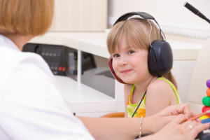 Young girl with audiologist
