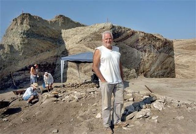 Archaeologist Kostadin Kisyov, Director of the Plovdiv Museum of Archaeology, is seen here during the excavations of the Great Ancient Thracian Mound near Bulgaria's Tatarevo where his team beat the treasure hunters to the discovery of four Thracian graves. Photo: 24 Chasa daily