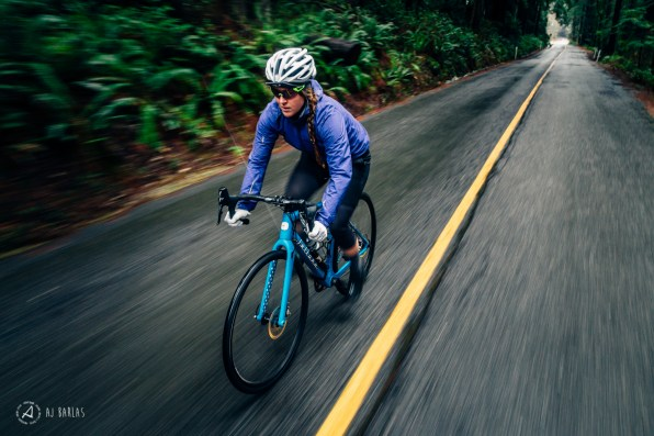 Sarah Leishman training on her road bike in the pouring rain