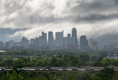 The Austin skyline as seen looking east over the Mopac highway Wednesday morning as fog and mist rise over Lady Bird Lake April 20, 2016.  RALPH BARRERA/AMERICAN-STATESMAN
