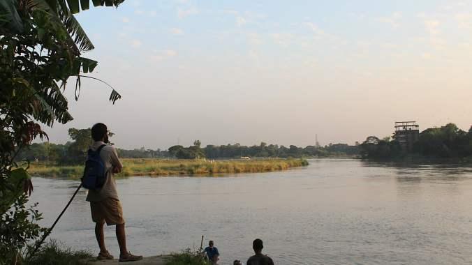 A CouchSurfer visiting Bangladesh by the river Dhaleshwari.