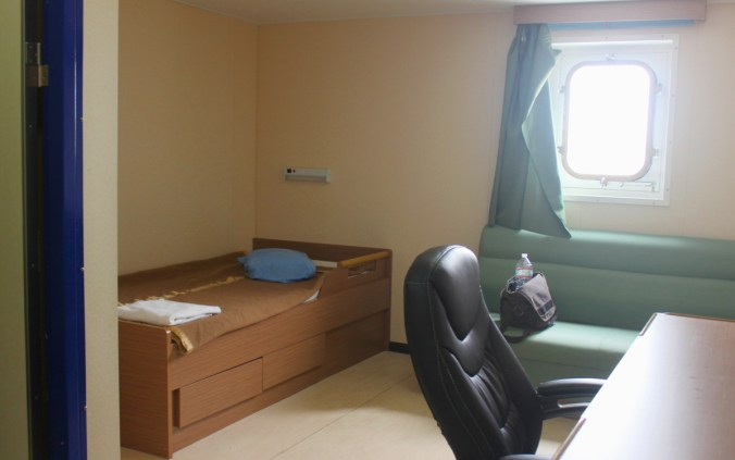 A basic cargo ship cabin used while traveling on a cargo ship as a passenger.