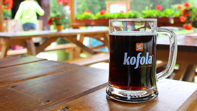 A glass of Kofola on a terace in the summer.