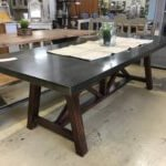 Vintage style dining table with a stunning metal top