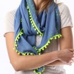 Scarf Blue With Pom Poms Two Colour Ways. The ever popular navy blue scarf with neon pink or yellow pom poms. This one is beautiful with a sense of fun and oozing style! shop buy online in store camberley surrey