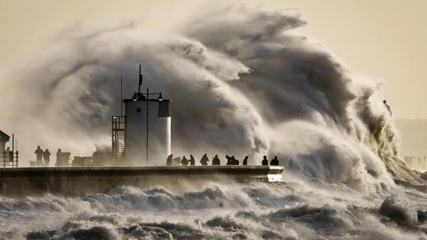 Big wave crashing during storm.