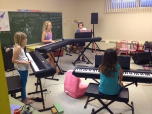 7-13 year-old girls leanring to play like rock stars.