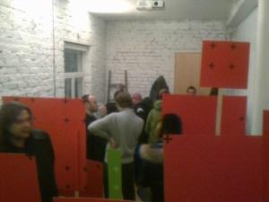 Оля Божко. Демонстрация. Картон, акриловая краска, деревянные рейки. 4 — 11 декабря 2011 года