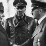 German Chancellor Adolf Hitler shakes hands with Head of State of Vichy France Marshall Philippe Pétain in occupied France on Oct. 24, 194