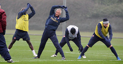 Beckham stretches with the Arsenal squad