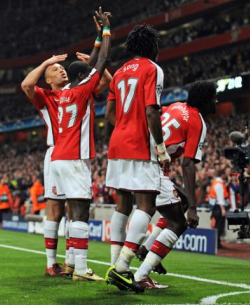 The four dancers celebrate Adebayor's goal