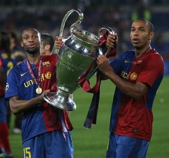 Henry holds the trophy aloft