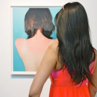 Which back is making waves_ The one in the photo or the person viewing the art
