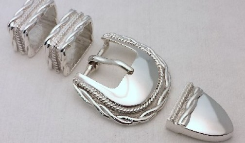 "Men's buckle plated with ""Bright Rhodium""."