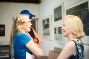 Beth Lilly shares a laugh with partygoers while she shows her current work in progress.