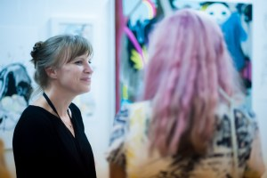 Sarah Emerson (left) smiles as she is complimented on her work.