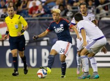 Sep 5, 2015; Foxborough, MA, USA; New England Revolution midfielder/forward Lee Nguyen (24) passes the ball during the second half of the New England Revolution's 3-0 win over the Orlando City FC at Gillette Stadium. Mandatory Credit: Winslow Townson-USA TODAY Sports