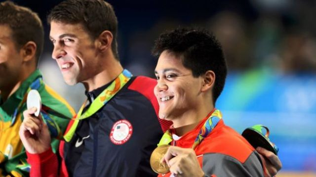 Joseph Schooling (SIN) of Singapore and Michael Phelps (USA) of USA pose with their medals.