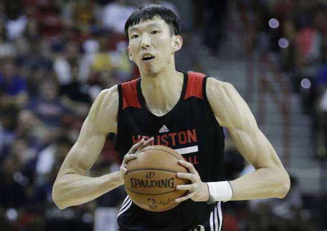Houston Rockets' Zhou Qi plays against the Phoenix Suns during the NBA summer league basketball game, Monday, July 10, 2017, in Las Vegas. (AP Photo/John Locher) Photo: John Locher, Associated Press / Copyright 2017 The Associated Press. All rights reserved.
