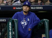 Los Angeles Dodgers' Yu Darvish watches from the dugout during the first inning of Game 4 of baseball's World Series against the Houston Astros Saturday, Oct. 28, 2017, in Houston. (AP Photo/David J. Phillip)