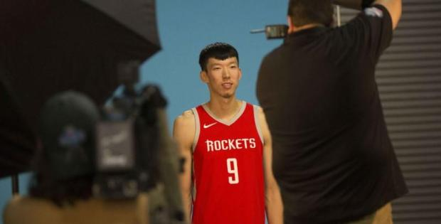 Sep 25, 2017; Houston, TX, USA; Houston Rockets forward Zhou Qi (9) poses for a picture during media day at Toyota Center. Mandatory Credit: Troy Taormina-USA TODAY Sports