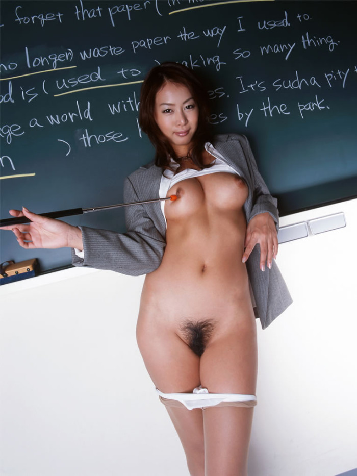 Asian teacher in sexy dress undressing in the classroom