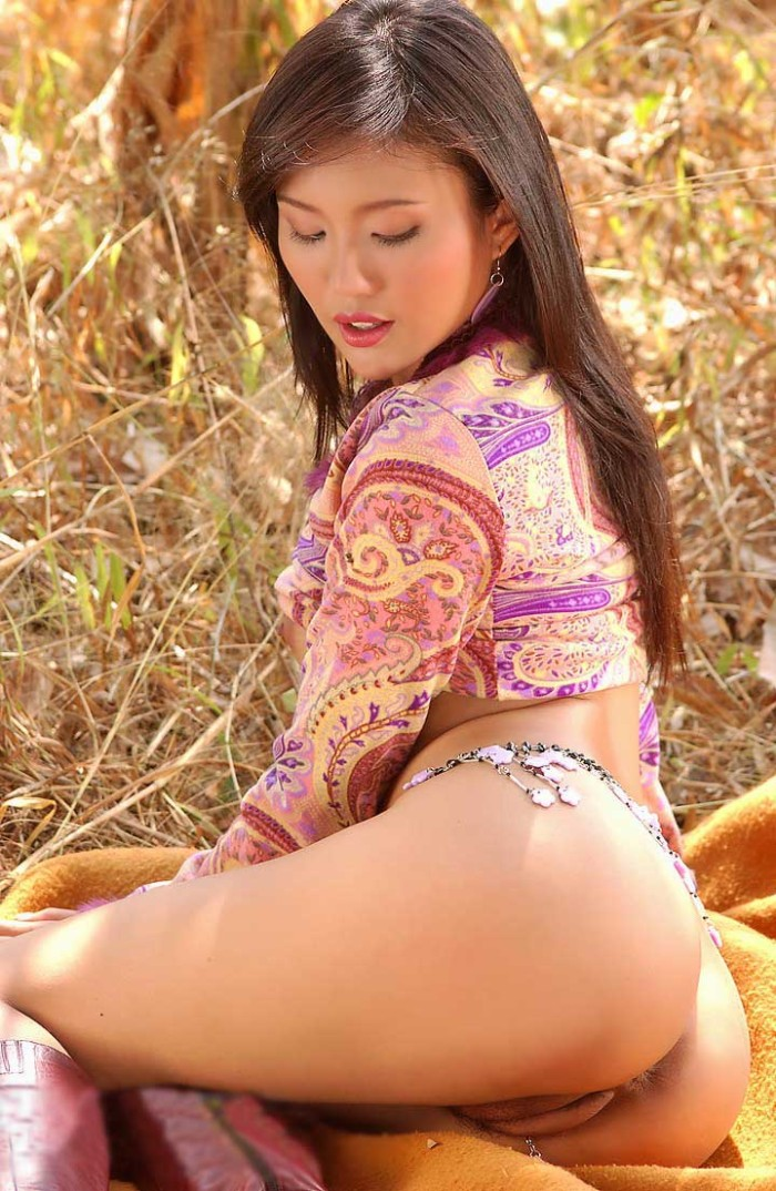Beautiful asian is undressing outdoors