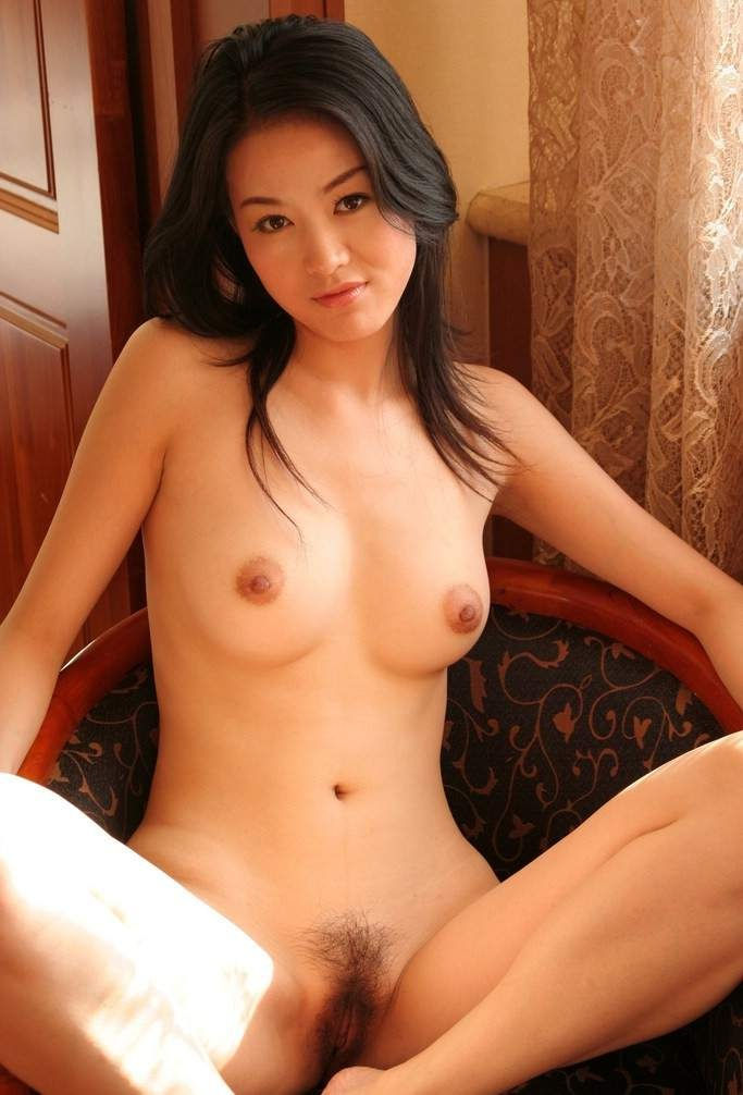 Skinny Japanese brunette is waiting for a hot action to start, while posing naked close to the camera.jpg