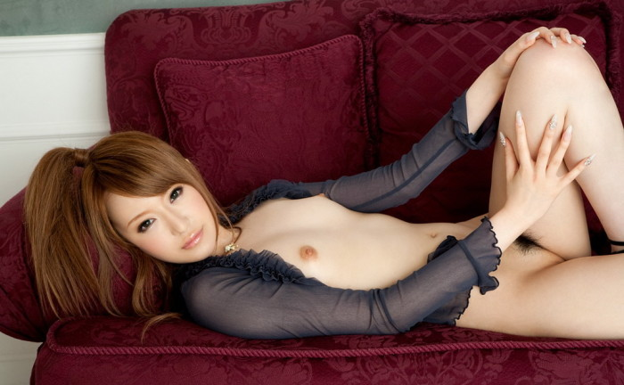 Skinny Japanese lady is laying on a sofa, while exposing her hairy pussy hole.jpg