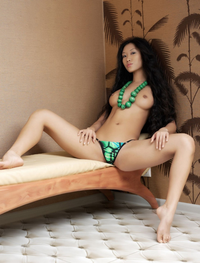 The most beautiful asian with long hair shows shaved pussy