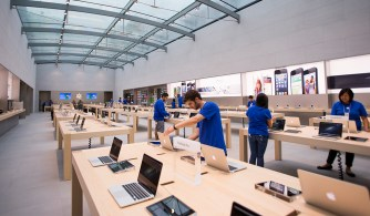 Two days before the grand opening, Apple employees put finishing touches on the display space of the new Palo Alto Apple Store on University Avenue on Thursday, Oct. 25, 2012.  (Dai Sugano/Staff)