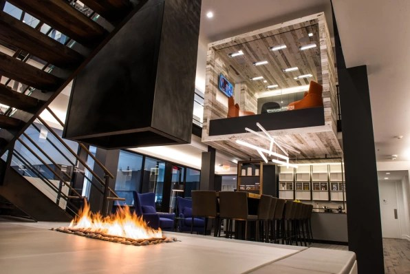 not so for the private equity firm atlas holdings which recently converted an old barn and residence into a cozy corporate campus that looks more office designs