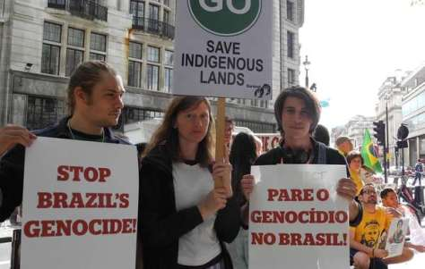 Survival supporters demonstrating outside the Brazilian embassy in London