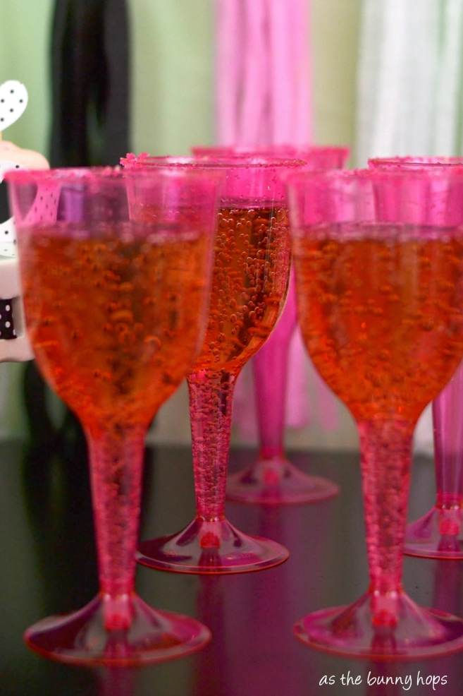 Pink champagne glasses are extra fun with a sugar rim.