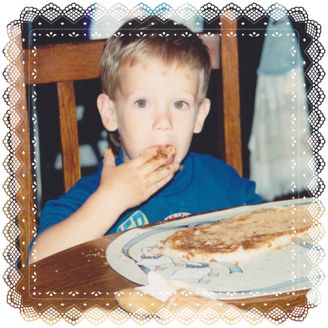 A photo of child-Dalton licking cinnamon and sugar from his fingers