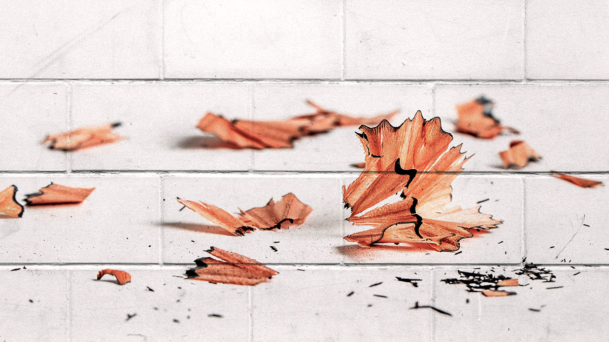 good boy background: pencil filings over white brick