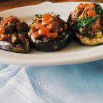http://athleticavocado.com/2014/06/28/easy-paleo-dinner-spicy-bruschetta-stuffed-eggplant/