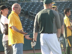"A's PR Director Bob Rose asking Brandon Moss and Josh Reddick, ""C'mon guys, why can't I take batting practice?"" Check out Bob's blog at: http://clubhouseconfidential.mlblogs.com/"