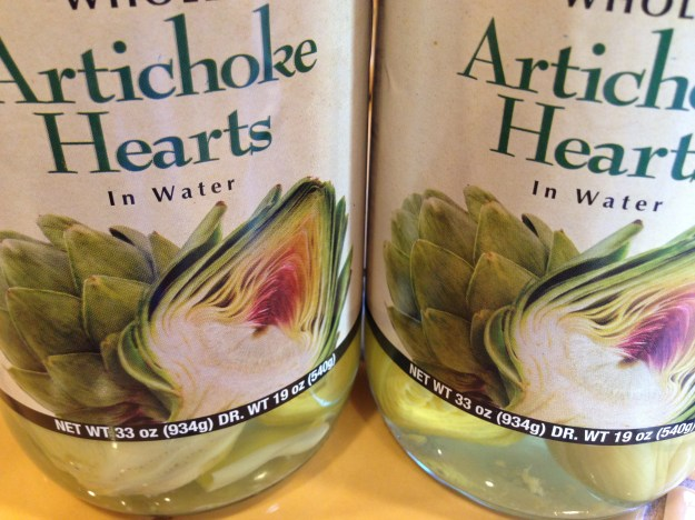 Buy artichoke hearts packed in water and you can season them any way you like.