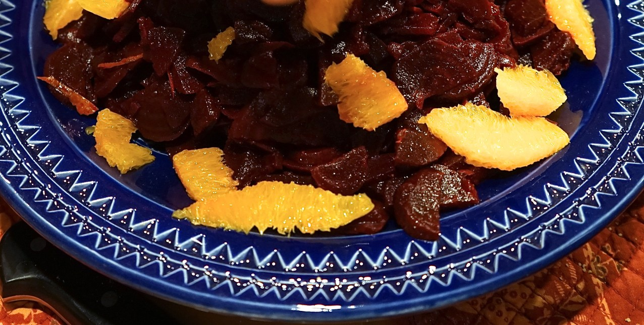 To serve, mound beets in center of platter, place orange segments around the perimeter and top with crumbled feta cheese.